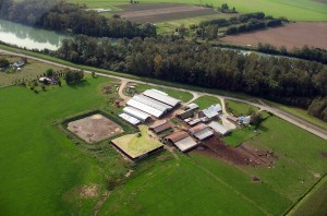 An aerial photo shows a manure lagoon at a dairy farm adjacent to the Nooksack River. Courtesy of Kim Koon